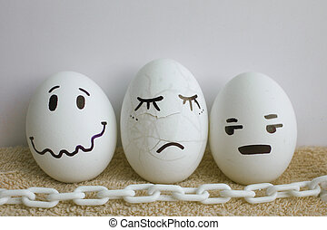 Eggs are funny faces. Concept: pain. White chain