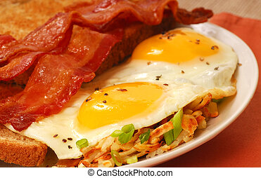 Eggs, bacon, toast and hash browns - Big breakfast of eggs,...