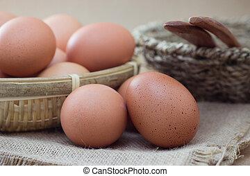 Eggs - Basket with eggs on sackcloth