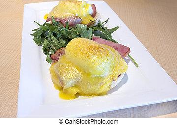 Eggs Benedict Breakfast Dish Closeup - Eggs Benedict with...