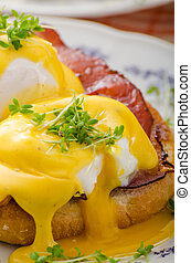 Eggs benedict, prosciutto topped with Hollandaise sauce