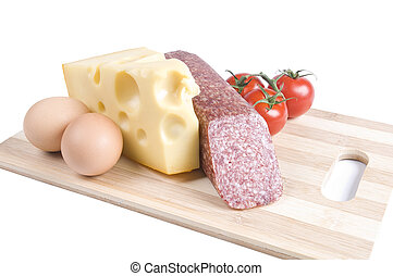Eggs, cheese, sausage and tomatoes