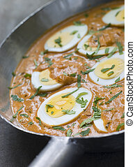 Eggs Cooked Moghali Style in a pan