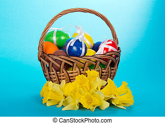 Eggs in a basket and narcissuses