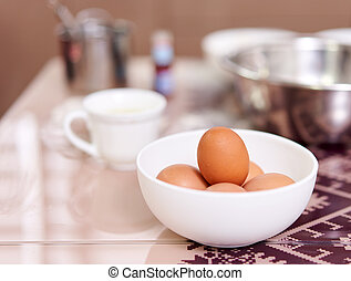 Eggs in a bowl on the table