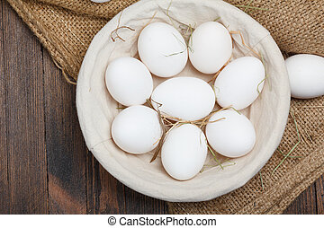 Eggs in a bowl on wooden table