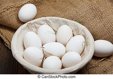 Eggs in a bowl with grass