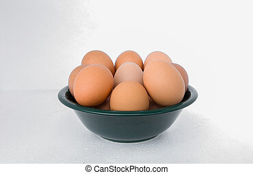 eggs in a cup on a white background