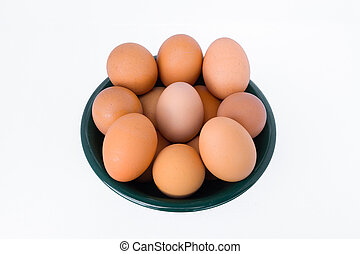 eggs in a cup on a white background.