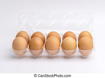 Eggs in a plastic box on the white background