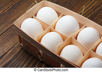 Eggs in a wooden tray