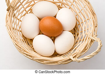 Eggs in basket isolated on white