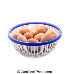 Eggs in basket isolated on white.