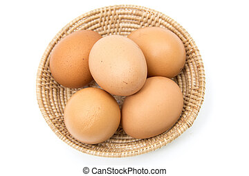 eggs in the basket on white