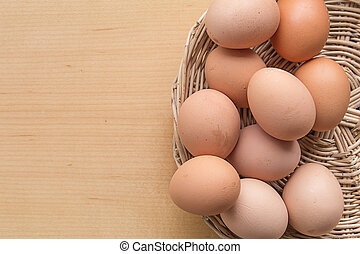 Eggs in the Basket on wooden table