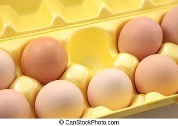 Eggs in yellow packing box.