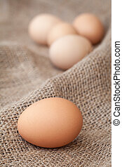 Eggs lay on sackcloth, selected focus