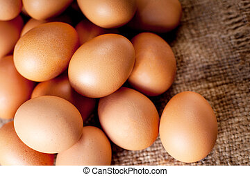 Eggs on wooden background closeup
