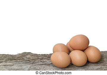 Eggs on wooden table background with white background