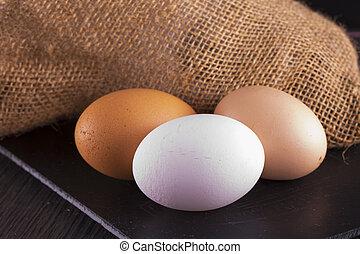 Eggs over black stone chopping board