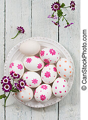 eggs with spring flowers, top view