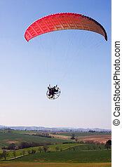 egy, gépi erejű, paraglider, pilóta, repülőjárat, felett, a, táj