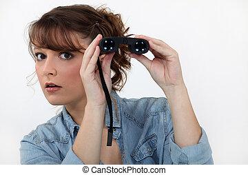 egy, nő, noha, egy, pár, közül, binoculars.