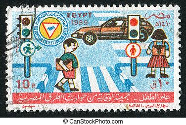 EGYPT - CIRCA 1989: stamp printed by Egypt, shows Crossroads, car, childrens, circa 1989