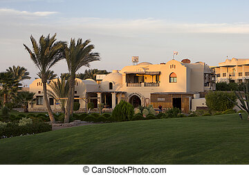 egypt - lawn, palm trees and buildings in marsa alam