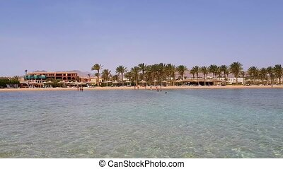 Beach with Umbrellas and Sunbeds in Egypt. Resort on Red Sea Coast.