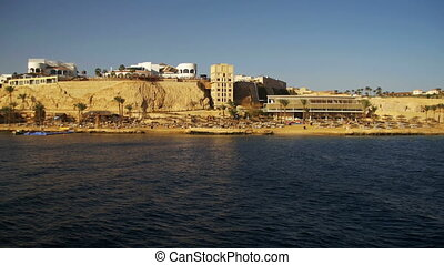 Red Sea coast with beaches, Palm and hotels. Boat Trip Sinai...
