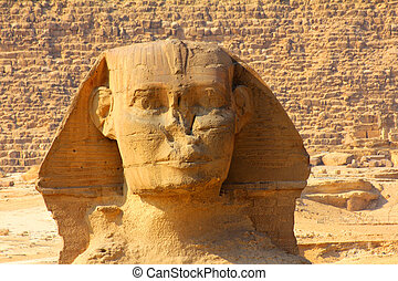 egypt sphinx face and pyramid in Giza