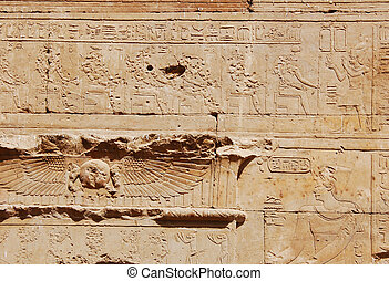 Egyptian engraved on wall at the entrance of Edfu temple,...