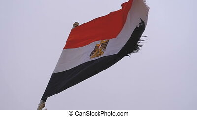 Egyptian flag fluttering on a boat in bad weather. Slow Motion