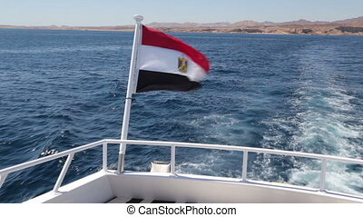egyptian flag on the white yacht sway on the wind in red sea