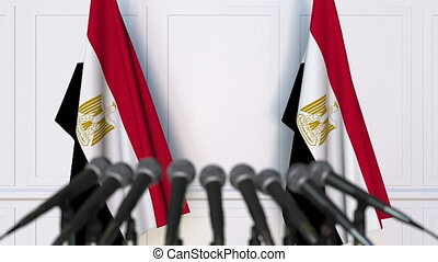 Egyptian official press conference. Flags of Egypt and...