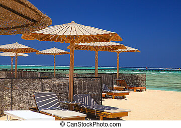 Marsa Alam, Egypt - Egyptian parasol on the beach of Red Sea...