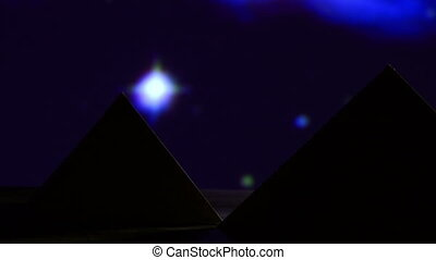 Egyptian pyramid, blue night, close