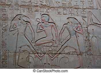 Egyptian relief with painting on wall in Karnak temple, ...
