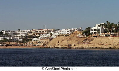 Egyptian sea with shore and hotels.