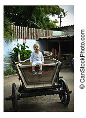 Eh, I will give a ride! - The little boy in a wooden cart