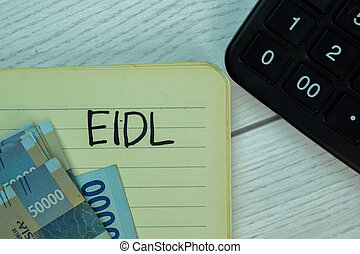 EIDL write on a book isolated on office desk.