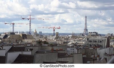 eiffel tour and Paris cityscape - clouds floating over...