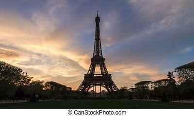 Beautiful 4K UHD timelapse of the Eiffel tower at sunset in spring in Paris, France