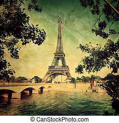Eiffel Tower and bridge on Seine river in Paris, France. ...