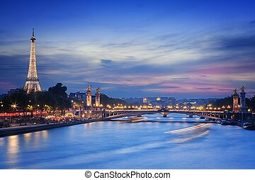 Eiffel Tower and Pont Alexandre III at nigh - PARIS -...