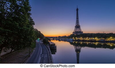 Eiffel Tower and the Seine river night to day timelapse,...