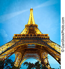 PARIS, FRANCE - SEPTEMBER 3: Illuminated Eiffel Tower at night. Blue night sky with clouds in background. The most popular tourist attraction in France. September 3, 2011, Paris, France, Europe.