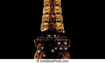 Striking light show at the Eiffel Tower in Paris, France. Close-up view.