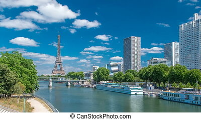 Eiffel tower at the river Seine timelapse from bridge in Paris, France